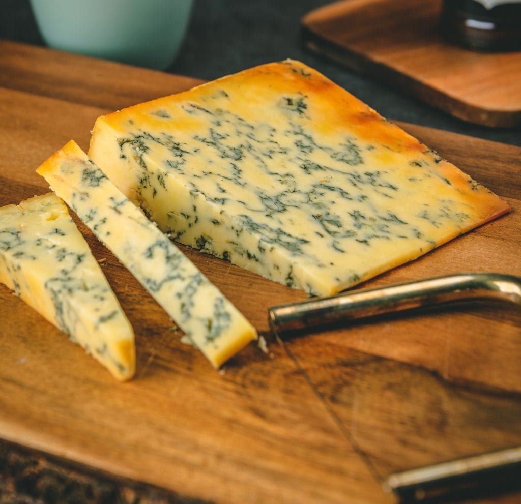 https://rustickitchendeli.com/collections/british-cheeses/products/feast-and-furious-oak-beech-wood-smoked-stilton-cheese